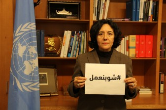 Leila Zerrougui, Special Representative of the Secretary-General for Children and Armed Conflict, holds a sign with the hashtag #WhatDoesItTake in Arabic. Copyrights: OSRSG-CAAC