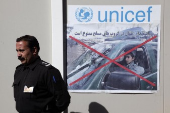 At the child protection unit in Herat's National Police recruitment centre, posters remind everyone that the recruitment of children is prohibited. ©United Nations